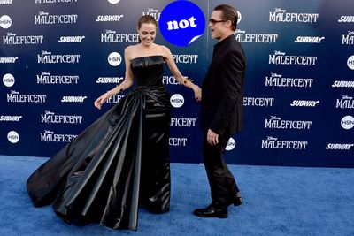 It's rare that Brad Pitt upstages his wife Angelina Jolie on the red carpet but her <i>Maleficent</i> premiere bin bag dress was the exception.