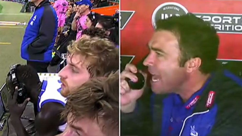 Daw cops a spray from Kangaroos' AFL coach Brad Scott