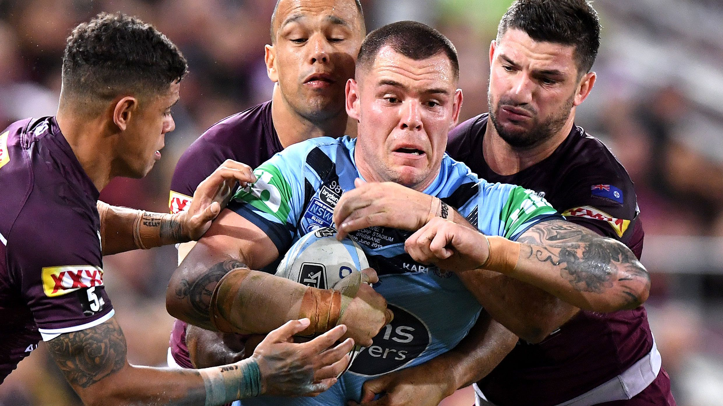 David Klemmer runs the ball for NSW.