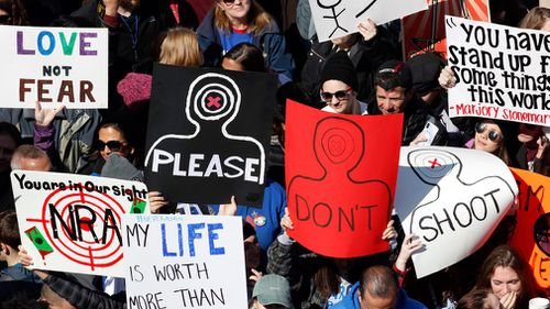 People hold signs during the March For Our Lives rally in Washington. (EPA/AAP)