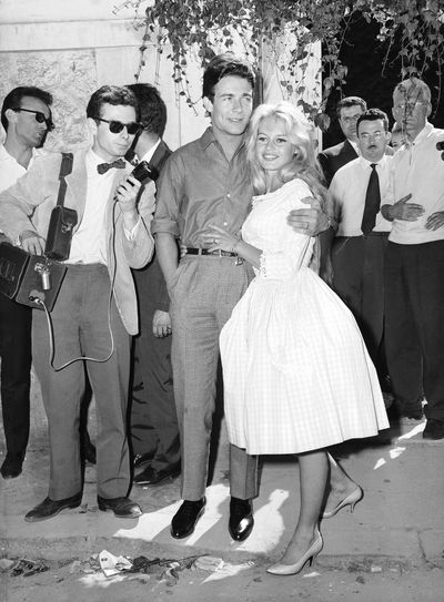 """<p>Brigitte Bardot and Jacques Charrier, 1959</p> <p>Dress: Jacque Estral</p> <p>The original French bombshell wore a pink gingham wedding dress for her  wedding to actor Jacques Charrier.</p> <p>According to the August issue of Life magazine: """"One of Paris' biggest stores is selling 8,000 Bardot Kerchiefs a month and 3,500 gingham dresses like the one Bardot wore at her Wedding. Said a Visiting US fashion editor, 'You can't buy a yard of checked gingham in Paris, not even for kitchen curtains, since Brigitte picked the fabric.'""""</p>"""
