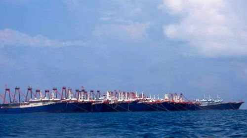 220 Chinese vessels are seen moored at Whitsun Reef, South China Sea.