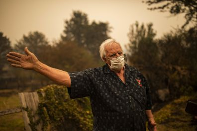 Roland (Roly) Hough in Cobargo, NSW, Wednesday, January 1, 2020. Several bushfire-ravaged communities in NSW have greeted the new year under immediate threat. (AAP Image/Sean Davey) NO ARCHIVING
