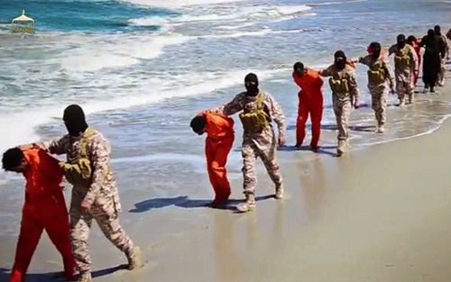 Members of an Islamic State affiliate walk captured Ethiopian Christians along a beach in Libya, before being executed (AAP)