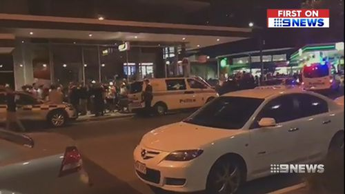 The chaos spilled onto the street outside the Triffid last night. (9NEWS)