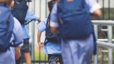 School children running into class in Australia