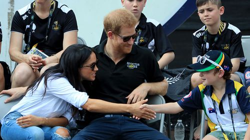 Markle greets a young Invictus Games fan. (AAP)