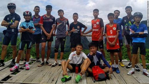 A picture taken of the 12 boys and their coach shortly before they went into the cave. Facebook