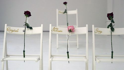 A pink rose was placed on a chair in memory of an unborn baby killed in the massacre. (AAP)