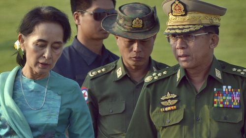 In this May 6, 2016, file photo, Aung San Suu Kyi, left, Myanmar's foreign minister, walks with senior General Min Aung Hlaing, right, Myanmar military's commander-in-chief, in Naypyitaw, Myanmar.