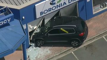 Car smashes into Melbourne pharmacy