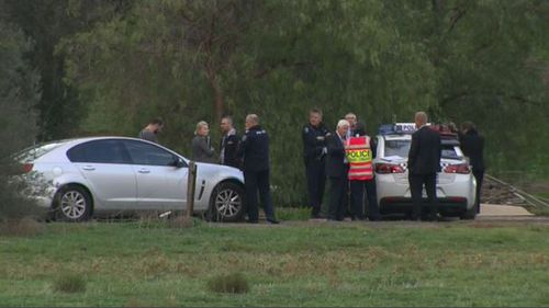 Police at the scene of the triple murders. (9NEWS)