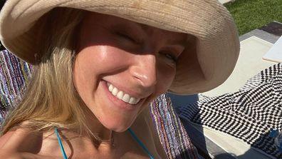 Jennifer Hawkins bikini baby bump pic 2021.