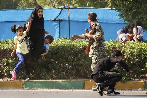 The attack, in which militants disguised as soldiers opened fire on an annual Iranian military parade in Ahvaz, was the deadliest attack in the country in nearly a decade. (AAP)