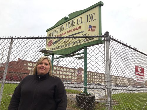 Jacquie Sweeney stands outside the Remington firearms factory in Ilion, New York. Ms Sweeney and her husband were among almost 600 workers fired by the company this week, a few months after Remington Outdoor Co. sought bankruptcy protection for the second time in two years