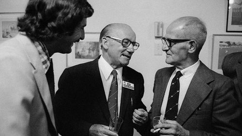 Sir Donald Bradman of Australia talking to former England bowler Harold Larwood (right) and Dennis Lillee of Australia in Melbourne, 1977.  (Patrick Eagar, Popperfoto, Getty Images)