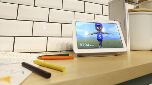 A Google Home Hub is displayed at the Google Assistant ride to show off the new features in its voice-enabled digital assistant as visitors ride along at the Google display area at CES International.
