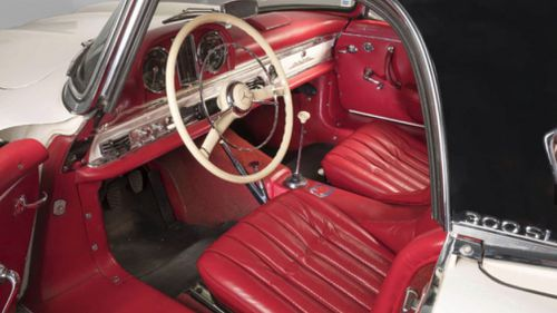 Eye-catching red interiors contrast with the snow-white body of the 300SL. Picture: Artcurial