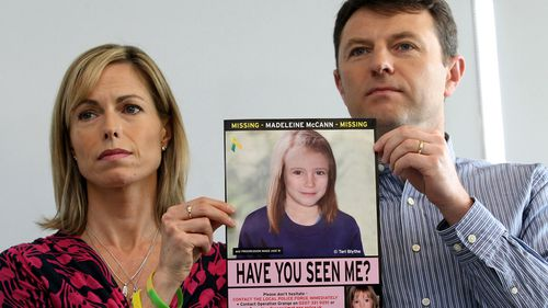 Kate and Gerry McCann with an image of what Madeleine may have looked like aged nine.