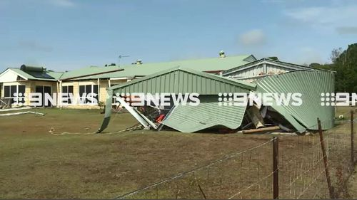 Daylight revealed the roof had been torn of the residence. (9NEWS)