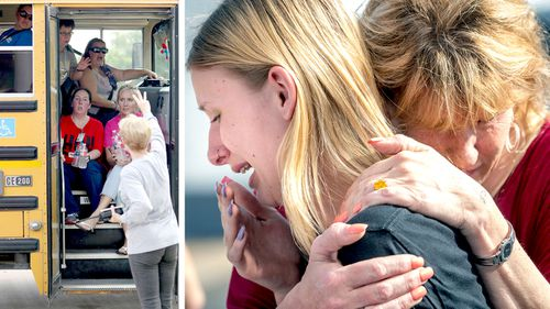 Staff members sit on a bus after a shooting at Santa Fe High School (left), and student Dakota Shrader is comforted by her mother Susan Davidson (right). Picture: AAP