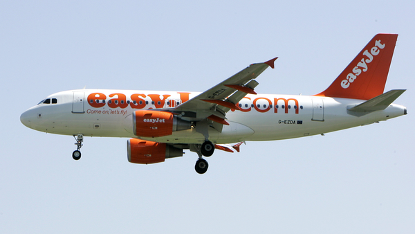 In this file photo dated Wednesday, April 23, 2008, an EasyJet jetliner lands at the Milan Linate airport, Italy. European budget airline eastJet said Thursday May 28, 2020, it plans to cut up to a third of its 15,000-strong workforce as the global aviation industry struggles to cope with the COVID-19 pandemic