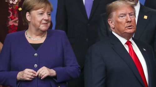 Chancellor of Germany Angela Merkel and US President Donald Trump stand onstage during the annual NATO heads of government summit on December 4, 2019 in Watford, England
