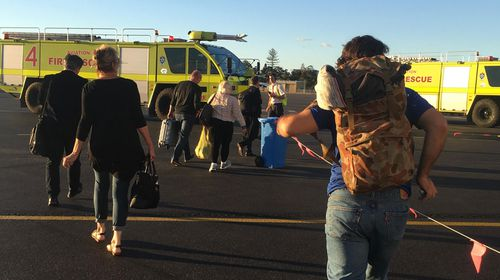 The plane was evacuated around 4:25pm on Friday after arriving from Melbourne. (Supplied)