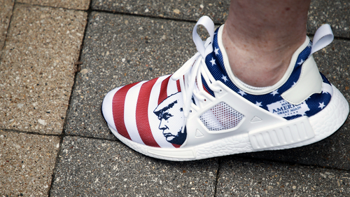 A protester wears a pair of shoes with President Donald Trump on them during a protest against the proposed citywide mask ordinance being voted on by Tulsa City Council at Tulsa City Hall on Wednesday, July 15, 2020. IAN MAULE/Tulsa World
