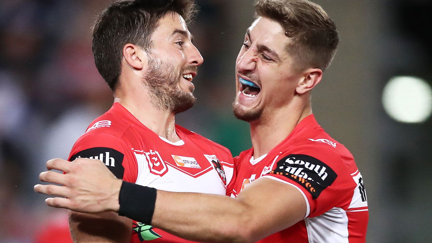 Ben Hunt of the Dragons (L) celebrates with Zac Lomax (R) after scoring a try