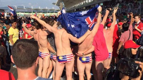 The Aussies celebrate countryman Daniel Ricciardo's win. (Nick Asyraaf/Twitter)