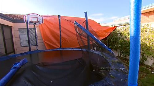 Parts of the patio ended up on a neighbour's carport and trampoline. Picture: 9NEWS