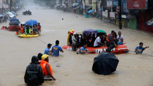 Tropical storm flooding shuts down Philippine capital