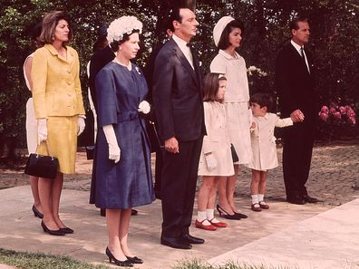 Queen Elizabeth II and Prince Philip with Jackie Kennedy and her children John Jr and Caroline during the inauguration of Britain's Kennedy memorial at Runnymede in 1965.