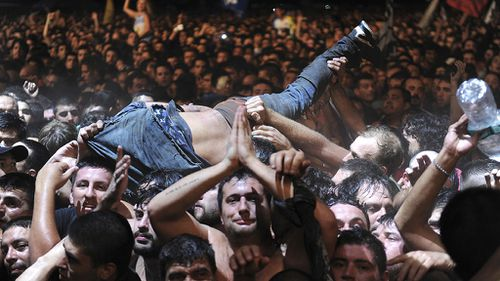 Two killed, a dozen injured in massive crowd at Argentine rock concert
