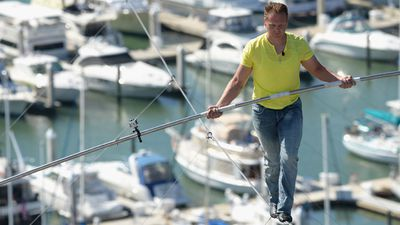 Sky high in Florida Wallenda walks across a tightrope and tests his balance. (Photo by Tim Boyles/Getty Images)