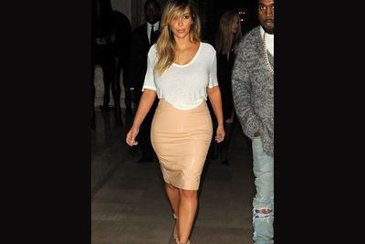 Sticking to neutrals, Kim threw on a PVC pencil skirt paired with a light cream tee for a romantic dinner at the Costes hotel in France. <br/><br/>She sure loves all things Givenchy, pairing her understated look with a pair of pastel pink pumps. <br/><br/>Source: Splash