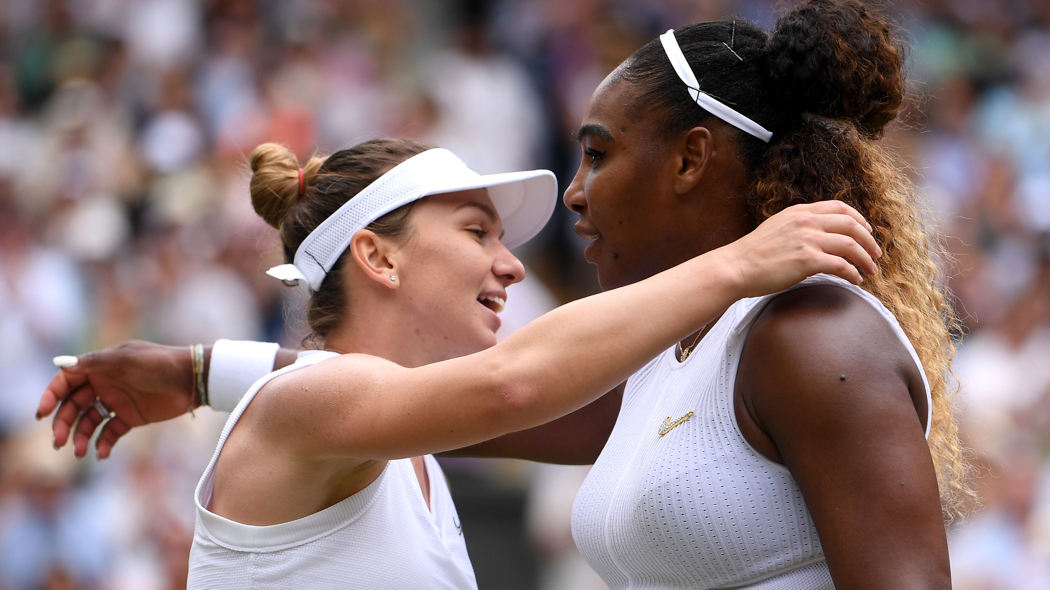 Simona Halep and Serena Williams embrace at the end of the 2019 Wimbledon final.
