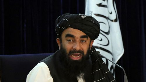 Taliban spokesman Zabihullah Mujahid speaks during a press conference in Kabul. The Taliban have announced a caretaker Cabinet stacked with veterans of their harsh rule in the late 1990s.