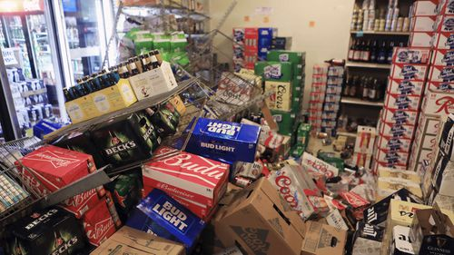 Alaska shop owner Owner Mary Funner says beer, wine and other bottled alcohol was strewn throughout store aisles after the quake. She considered closing Friday until customers began lining up.