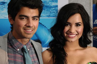 Fellow Disney Princess Demi Lovato copped the exact same fate as Taylor, with gutless Joe doing the dirty work over the phone <i><b>yet again!</i></b>
