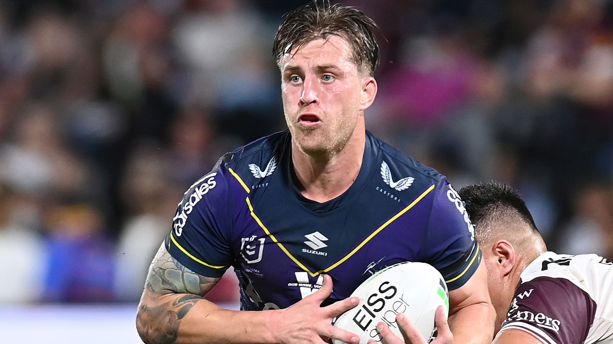 Cameron Munster runs the ball in the Storm's qualifying final win over Manly.