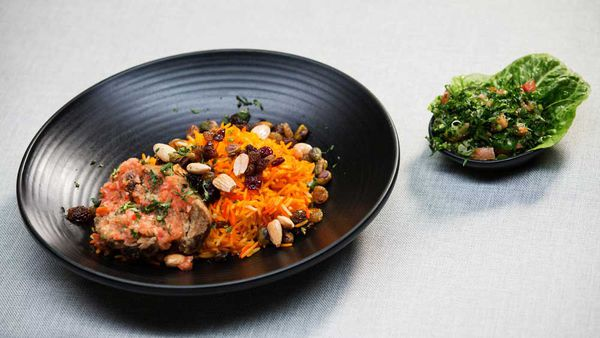 The Shahrouk's lamb kabsa with tomato salsa, tri colour rice and tabouli