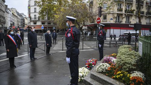 Paris Mayor Anne Hidalgo, left, and French Prime Minister Jean Castex, 2nd left, participate in a wreath laying ceremony, marking the 5th anniversary of the Nov. 13, 2015 attacks outside the Bonne Biere cafe bar in Paris, Friday, Nov. 13, 2020