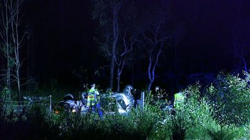 A vehicle with three people inside had been travelling south when it left the road, crashed through a fence and rolled.