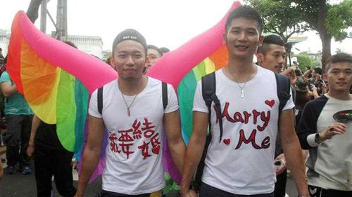The march was to urge parliament to push through a controversial bill recognising same-sex marriage. (AAP)