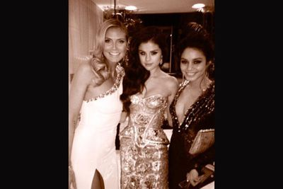 Wonder if Mother Hen Heidi gave Selena some advice on her troubles with Biebs? Seriously though, Heidi looks like the most fun to party with.<br/><br/>Image:Heidi Klum/Twitter