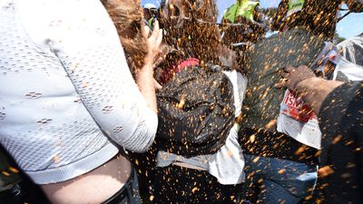 Protesters are sprayed with capsicum spray in Melton. (AAP)