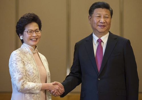 Chinese President Xi Jinping poses with Carrie Lam ahead of a meeting in Hong Kong, in 2017.