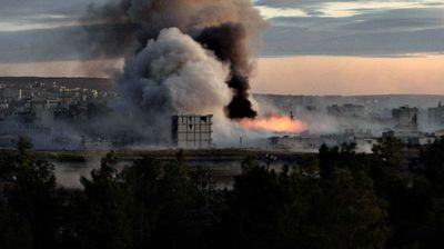 <p>Smoke and flames rise after an apparent US-led strike on Kobane, Syria.</p>